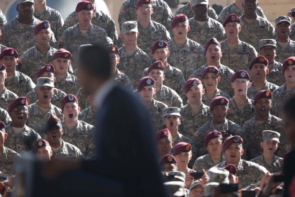 President Barack Obama flanked by soldiers at Fort Bragg, N.C.